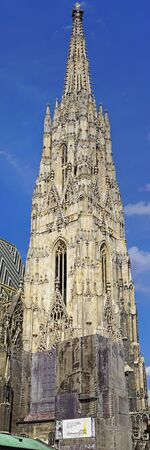 mediaval: VIENNA, AUSTRIA - JULY 10, 2015: Renovation of St. Stephens Cathedral Spire in Vienna. Facade reconstruction of Stephansdom Roman Catholic Church Tower.