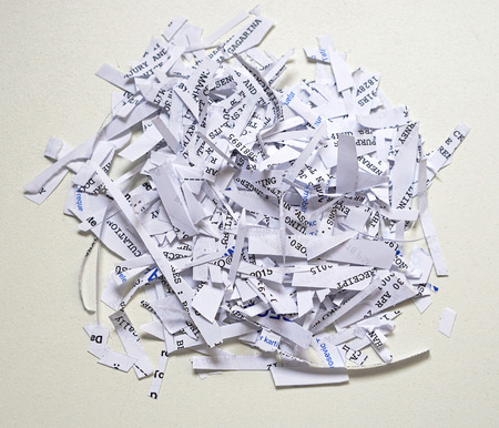 shredding: Shredding paper with confidential and senzitive private documents