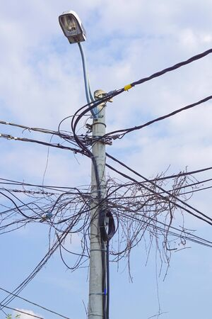 utility pole: Utility pole with bunch of electric wires and cables Stock Photo