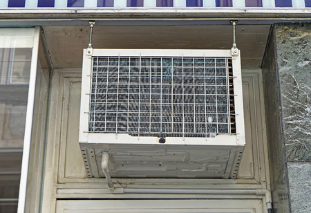 window: Window air conditioner unit above door