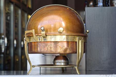 warmer: Brass food warmer chafing dish at buffet