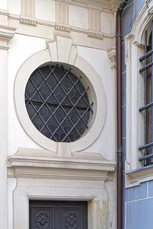 round window: Round window with bars above door