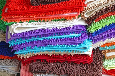 floor mats: Pile of colorful bathroom rugs and floor mats