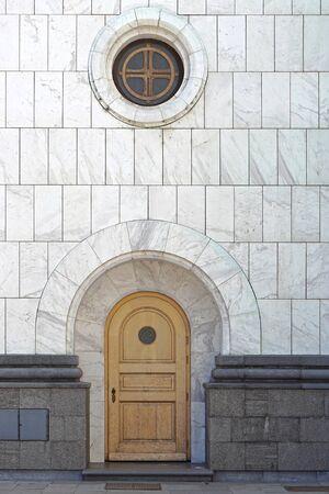round window: Arch door and round window at marble church in Belgrade