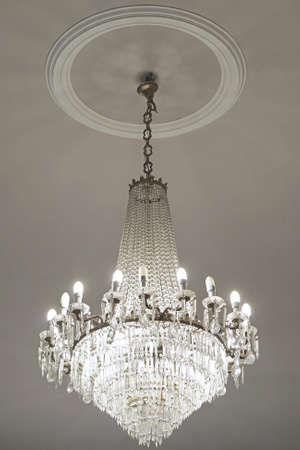electric fixture: Crystal chandelier with cfl energy saver lamps Stock Photo