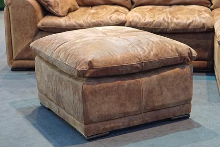 footstool: Big leather footstool in living room