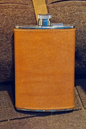 hip flask: Hip flask covered with brown leather Stock Photo
