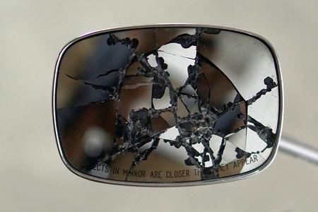 Broken rear view mirror at motorcycle Imagens