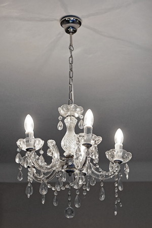Crystal chandelier with incandescent light bulbs