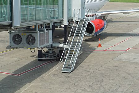Skybridge passenger boarding bridge at airport Stock Photo - 78669159