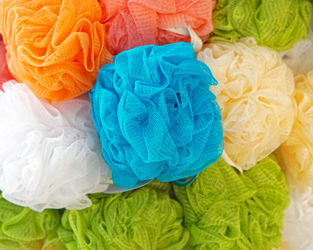 Plastic mesh pouf bath sponges Stock Photo