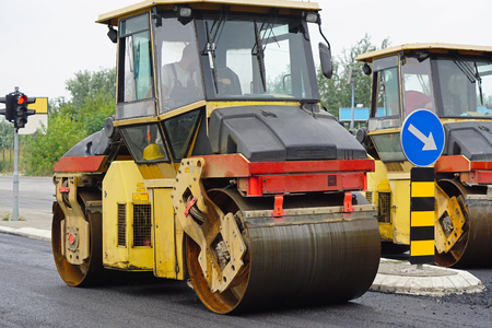 asphalting: Asphalting works surfacing road roller