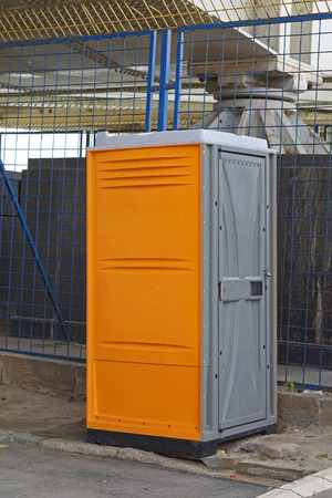 Portable toilet cabin at construction site