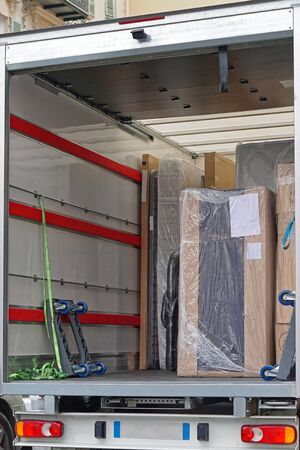 Packed furniture shipment in delivery truck Stok Fotoğraf