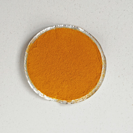 tumeric: Tumeric spice in small round package
