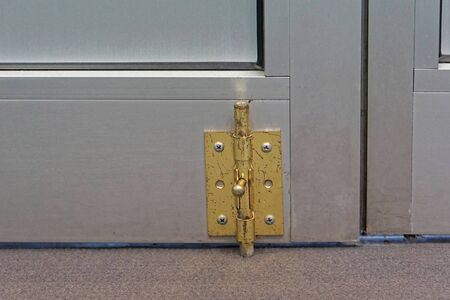 Latch lock at bottom of aluminum door Imagens - 89992837