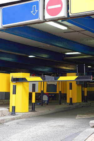 Parking garage entrance with barrier ramp