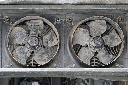 Two industrial cooling fans covered with dust and dirt Foto de archivo
