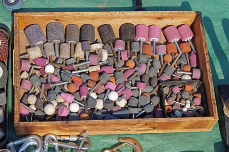 Grind stone bits tools in wooden box