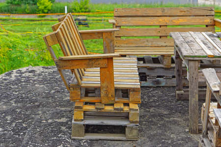 Bench made from used cargo pallets recycling