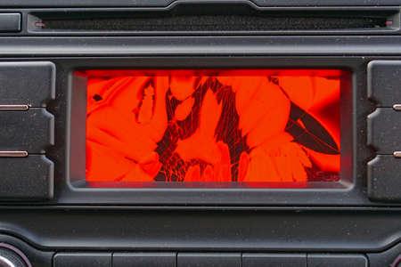 Broken red liquid crystal display in car dash board