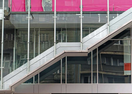 Long stairs in commercial building behing glass