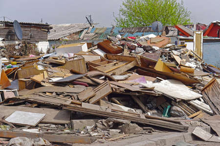 Big pile of wooden material debris at shanty town
