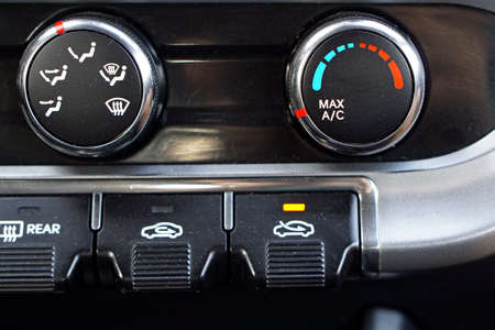 Air conditioner control buttons temperature in car