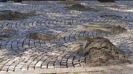 Laying cobblestone street pavement traditional way
