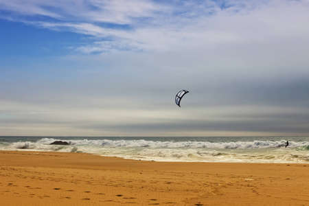 Kiteboarding at Guincho beach located close to the Portuguese city of Cascais.