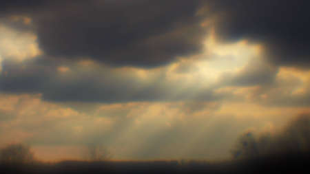 Sun rays struck through the clouds. Photo made using monocle. 16x9 wide screen aspect ratio.
