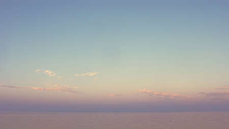 16x9 wide screen aspect ratio background - simple sunset on the sea in pastel tonality