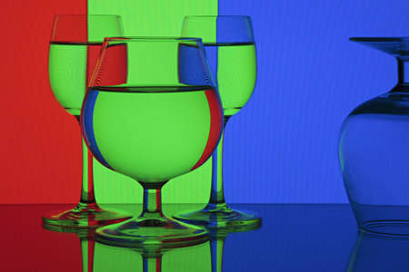 Abstraction - RGB (red, green, blue).Glasses on colorful background.