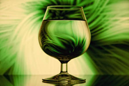 Still life - Glass on green abstract background Stock Photo