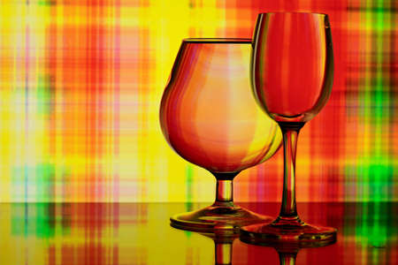 Two glasses on colorful abstract background