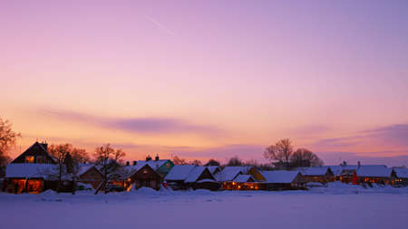 16x9 wide screen aspect ratio background. Winter sunset in Trakai, Lithuania.