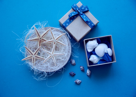 beach wrap: starfish, seashells and a box on the table, gifts with their own hands
