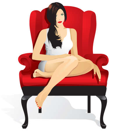 A beautiful woman with long hair sits in a red armchair with legs tucked in.