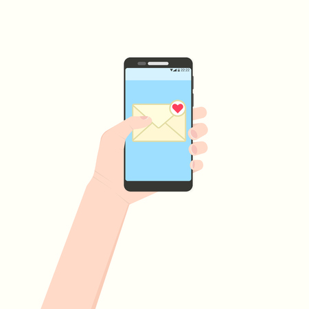 Left hand holding smartphone with new unread love message. European handle mobile phone with his finger touching yellow envelope sign on blue screen.