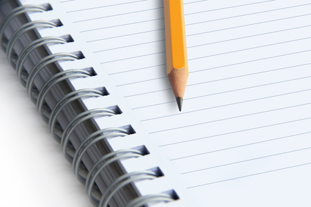 image of a notebooks and pencil on white , close-up
