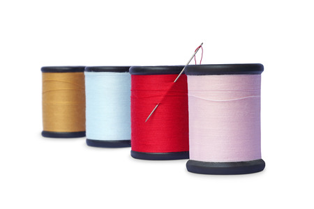 colorful sewing Threads isolated on white  photo
