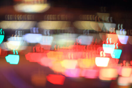 Colorful bokeh coffee cup shape ,city  at night photo