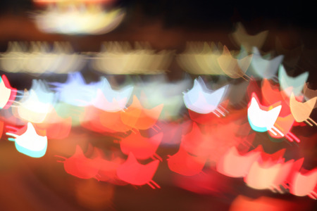Colorful bokeh cat head shape ,city  at night Stock Photo