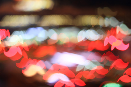 Colorful bokeh mustache shape ,city  at night