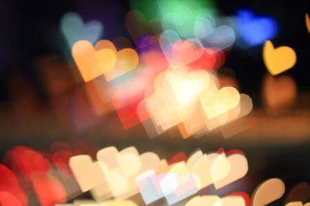 Colorful bokeh heart shape ,city  at night Stock Photo