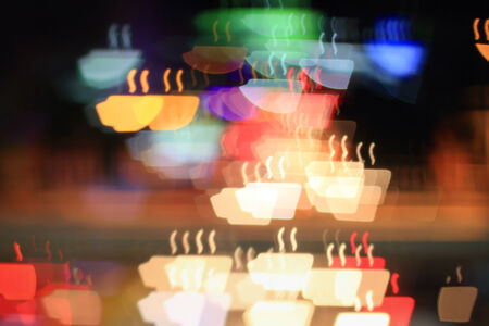 Colorful bokeh coffee cup shape ,city  at night