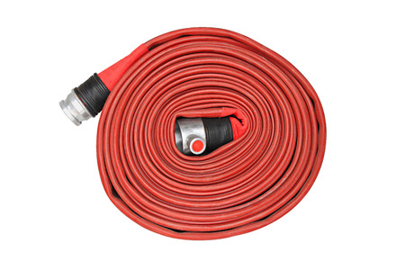 Red fire hose winder through use of firefighters on white background Stock Photo