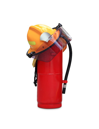 emergency vest: chemical fire extinguisher and safety helmet through the use of firefighters in thailand isolated on white background Stock Photo