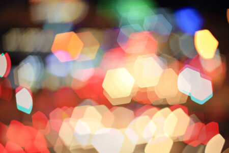 Colorful bokeh hexagon shape ,city  at night photo