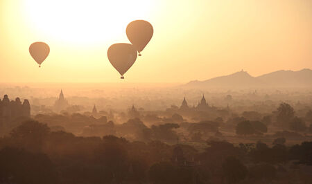 Silhouette of Hot Air Balloons over the temples of Bagan in misty morning, Myanmar Stock Photo